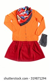 Woolen cardigan, scarf,pleated skirt and leather gloves on white background.