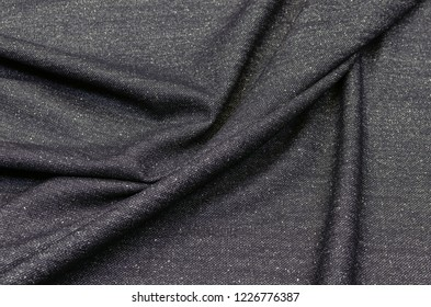 Woolen fabric of black color in a white speck