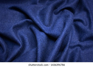 Woolen fabric, knitwear. The color is blue. Texture, background, pattern.