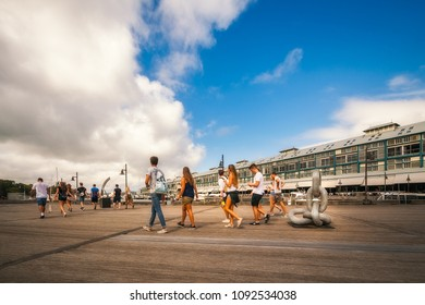 Woolloomoolloo, Sydney, Australia -January 26, 2018: People walking to join the celebrations on Australia Day at Woolloomoollo Bay Waterfront. The old wharf has been transformed for a modern lifestyle