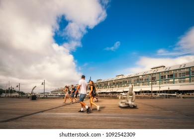 Woolloomoolloo, Sydney, Australia -January 26, 2018: People walking at Woolloomoollo Bay Waterfront. The old wharf built in 1915 has been transformed to suit a modern lifestyle.