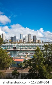 Woolloomooloo Bay, Sydney, Australia -September 03, 2018: Sydney City Views and at Woolloomoolo Bay with Royal Australian Navy ships in the foreground on a beautiful sunny morning.