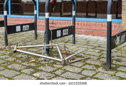Woolwich, UK - 5 October 2019: Remaining frame from bicycle chained to storage posts in East London