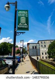 Woonsocket, RI/USA- August 18, 2019. Image taken of the entry to the Historic downtown Woonsocket. Also visible is a lamp light poll with a downdown Woonsocket image.