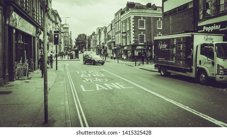 Worcester, England - June 3, 2019: Looking Down The Foregate Towards The Cross, Black and White Split Toning Street Photography