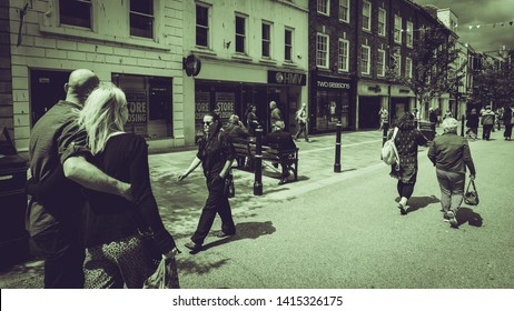 Worcester, England - June 3, 2019: City Life on High Street Worcester, Black and White Split Toning Street Photography
