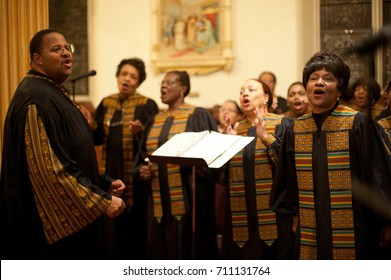 WORCESTER, MASSACHUSETTS - MARCH 6, 2011: Archdiocese of Boston Black Catholic Choir Director Meyer J. Chambers and member Joyce Durst (foreground) perform at St. Peter's Catholic Church in Worcester.