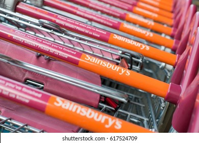 WORCESTER, UK - APRIL 2017: Sainsbury's supermarket trolleys stacked in a line.