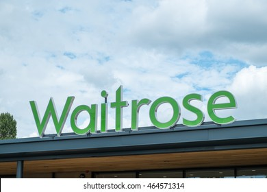 WORCESTER, UK - AUGUST 2016: Waitrose supermarket sign atop a store exterior