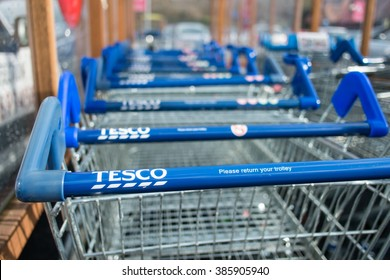 WORCESTER, UK - MARCH 2016: Tesco supermarket trolleys stacked in a line