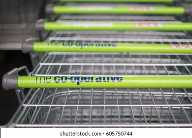Worcester, UK - March 2017: Co-op supermarket trolleys stacked in a line.