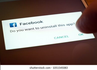 Worcester (UK) - March 2018: A user uninstalling their Facebook app.