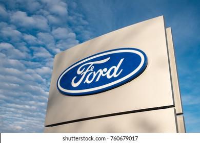 Worcester (UK) - November 2017: Ford dealership sign against a blue sky.