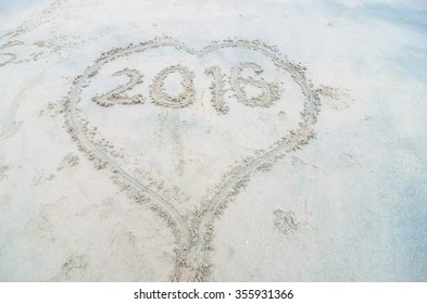 "The word ""2016"" written on the sand of the beach at Teluk Batik, Perak, Malaysia. Heart/Love Symbol is drawn outside the word ""2016""."
