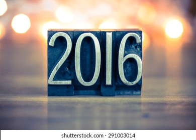 The word 2016 written in vintage metal letterpress type on a soft backlit background.