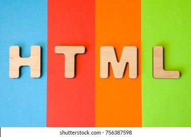 Word or abbreviation HTML, meaning HyperText Markup Language as internet programming language, is on background of four colors: blue, red, orange and green. HTML symbol as  programming language