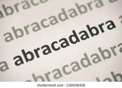 word abracadabra  printed on white paper macro