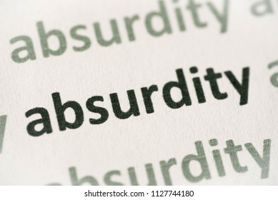 word absurdity printed on white paper macro