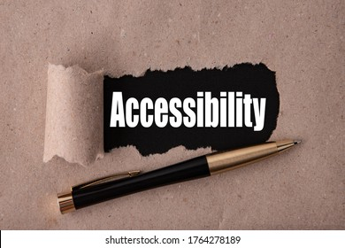 The word Accessibility is written under tear paper on a black background with a pen