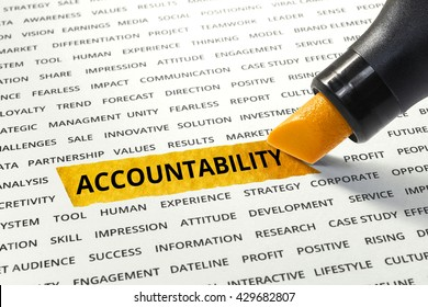 Word Accountability highlighted with marker on paper of other related words.business success concept.