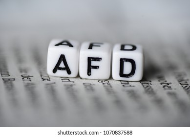 Word AFD formed by wood alphabet blocks on newspaper german party politics