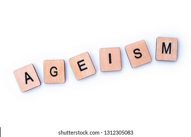 The word AGEISM, spelt with wooden letter tiles over a white background.