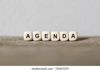 Word AGENDA made with wood building blocks,stock image