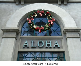 The Word Aloha and Christmas Wreath on side of Aloha Tower building. Aloha Tower is a lighthouse that is a landmarks of the state of Hawaii in the United States. Opened on September 11, 1926.