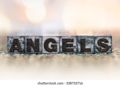 "The word ""ANGELS"" written in vintage ink stained letterpress type."