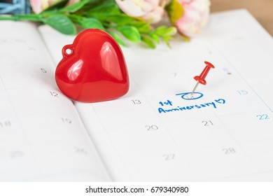 word anniversary celebration plan on calendar with   flower and red heart sign,