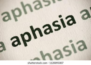 word aphasia printed on white paper macro