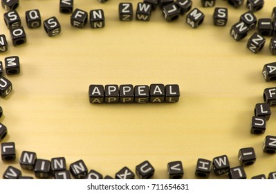 The word appeal on wood background