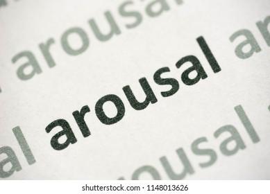 word arousal printed on white paper macro