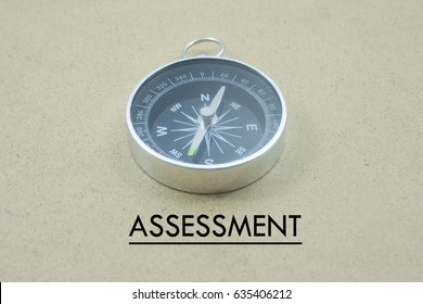 word assessment  with compass over yellow background