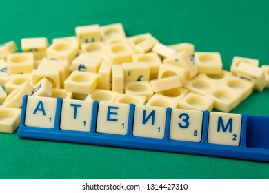 """Word """"ATHEISM"""" on  russian language written with Scrabble letters"""