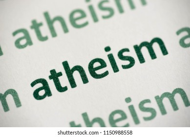 word atheism  printed on white paper macro