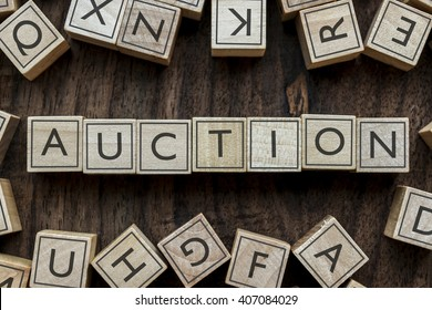 the word of AUCTION on building blocks concept