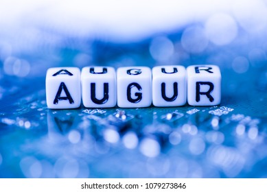 Word AUGUR formed by alphabet blocks on mother cryptocurrency