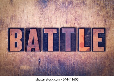 The word Battle concept and theme written in vintage wooden letterpress type on a grunge background.