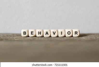Word BEHAVIOR made with wood building blocks,stock image