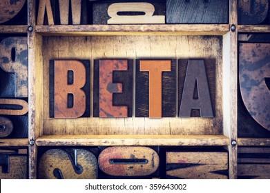 """The word """"Beta"""" written in vintage wooden letterpress type."""