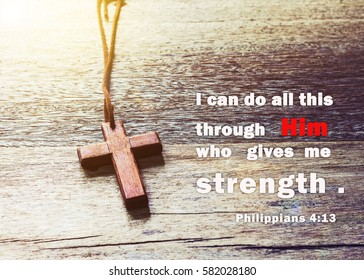 word from bible verses Philippians 4:13 I can do all this through him who gives me strength. on wooden background with wooden cross