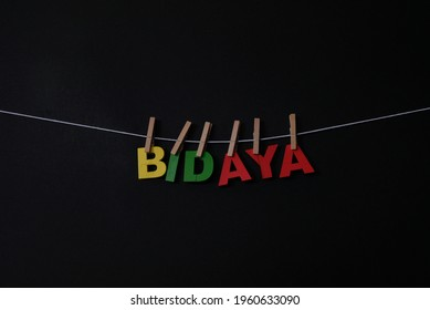 Word Bidaya on black background. Bidaya means good bye in Bengali. Concept for art, learning, and education.