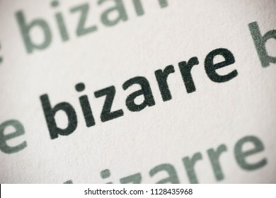 word bizzare printed on white paper macro
