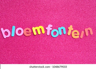 The word Bloemfontein on a pink background