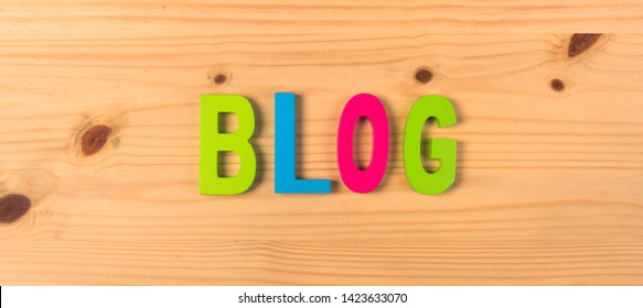 word blog written on wood in colorful letters