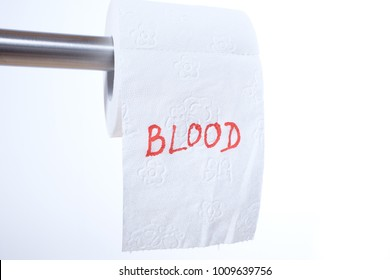 The word Blood in red letters on a toilet paper roll