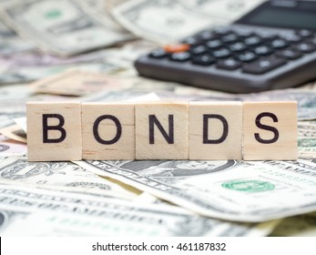 "Word ""BONDS"" in wooden block on US Dollar bills"