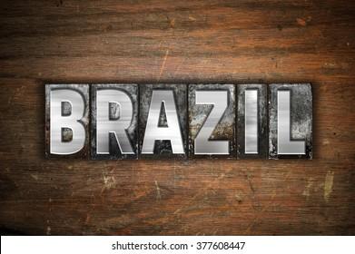 "The word ""Brazil"" written in vintage metal letterpress type on an aged wooden background."