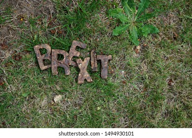 "The Word ""Brexit"" Showing a Depiction of Faeces to the Shaped Letters, Laid on Rough Grass."
